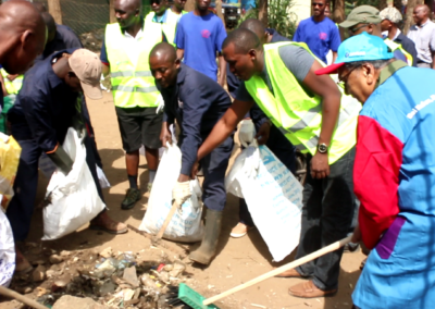 Dr. Chandaria at a clean up exercise in Kariongi,the waste was later used for cooking